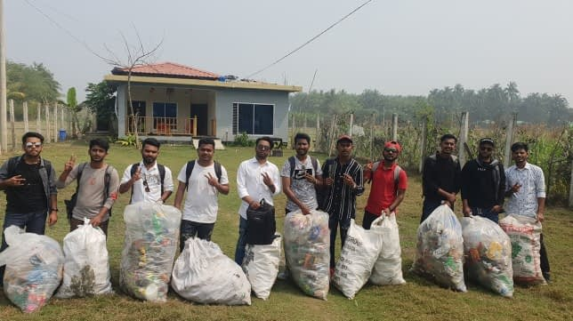 Group photo with collected trash